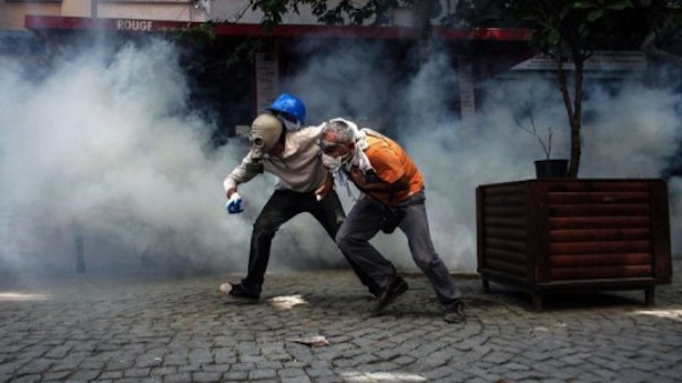 Demonstrators-try-to-escape-from-riot-police-on-June-11-2013-on-Taksim-square-in-Istanbul-AFP-Angelos-Tzortzinis