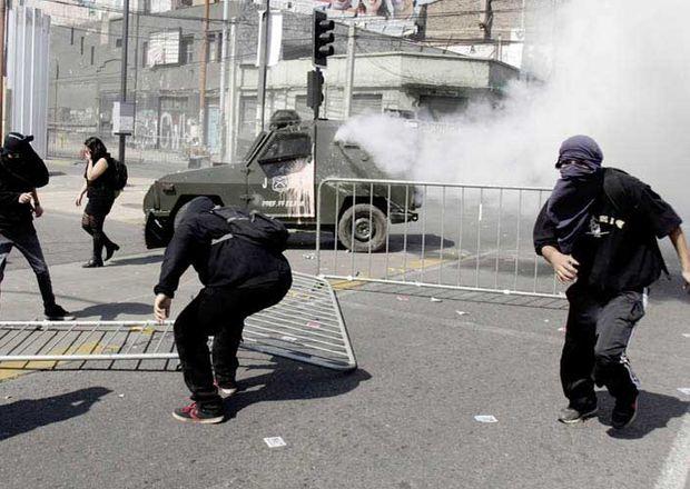 Protestas-Pinochet-Gobierno-Salvador-AFP_ECMIMA20130908_0199_4